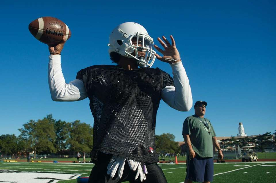 A player throws a pass during practice at