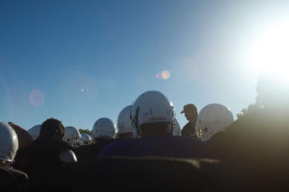 Head coach George Kasimatis gives instructions before practice