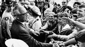 Republican presidential candidate Barry Goldwater greets supporters during