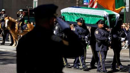 The coffin carrying former NYPD Chief John F.