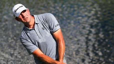 Lucas Glover hits a shot on the 15th