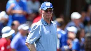 New York Giants part owner John Mara watches