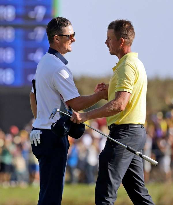Justin Rose, left, of Great Britain and Henrik