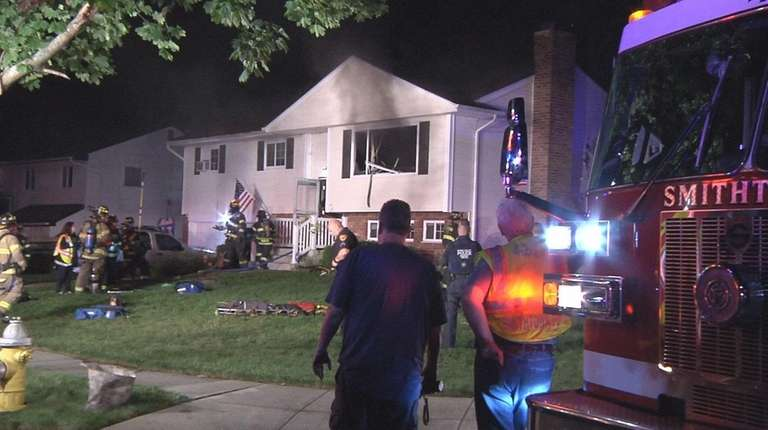 Firefighters rescued a woman and her two children