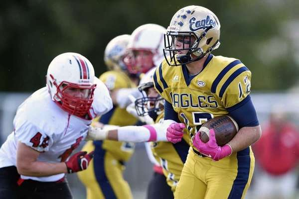 Tom Galgano of Bethpage runs the ball against