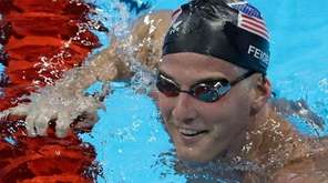 U.S. swimmer James Feigen smiles during a swimming