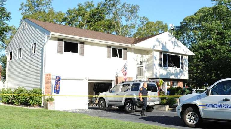 Officials remained at the scene of a house