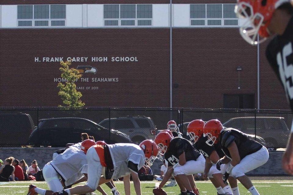Players runs drills during practice at Carey High