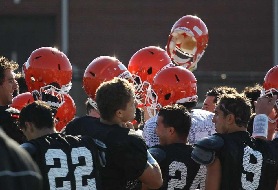 Players celebrate the end of drills during practice