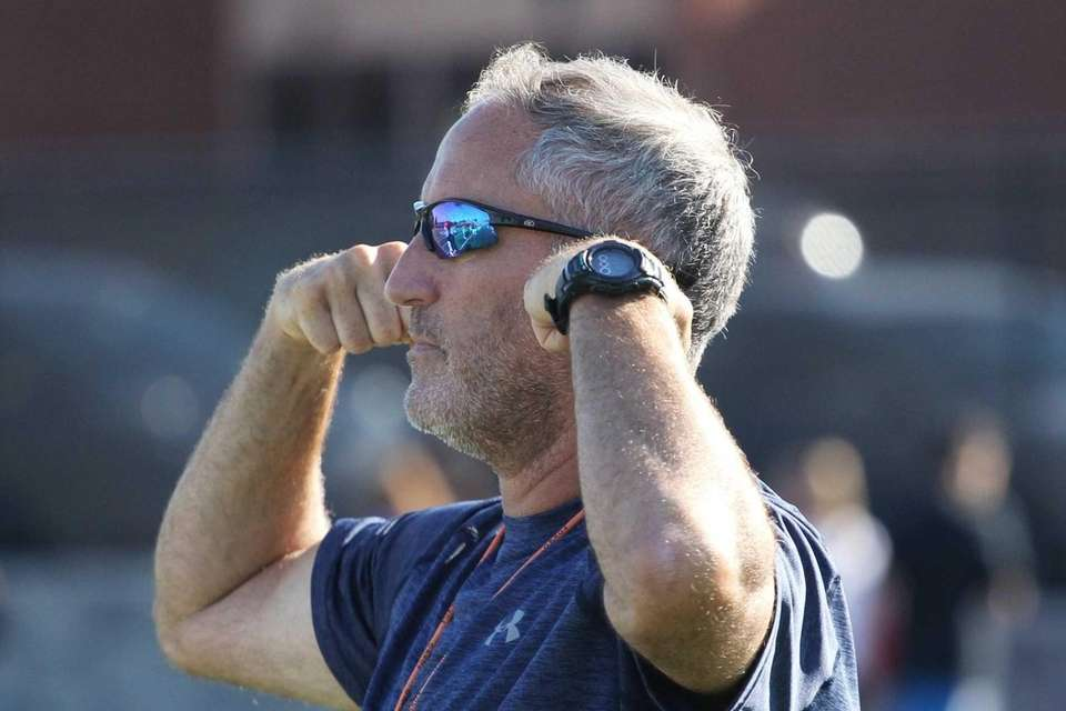 Tom Aiello looks on during practice at Carey