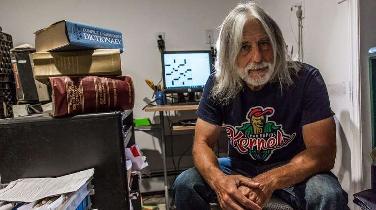 Fred Pisco, working in his tiny Bellmore apartment,
