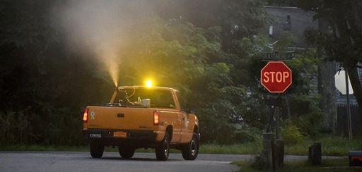 A Suffolk County public works vehicle ground sprays