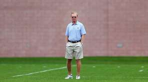Giants president and co-owner John Mara watches practice