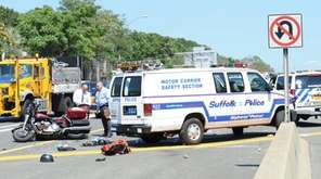 A motorcyclist and a police vehicle collided Wednesday