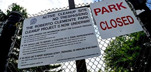 Active Cleanup Site signs hang on the gates