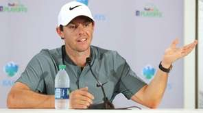 Rory McIlroy of Northern Ireland speaks to the