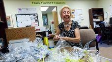 Eileen Wren, 79, of St. James, readies party