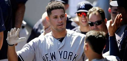 Gary Sanchez is congratulated on his home run