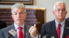Suffolk County Executive Steve Bellone, with Comptroller John