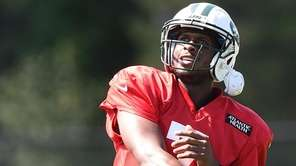 New York Jets quarterback Geno Smith follows through