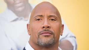 Dwayne Johnson elbowed Robert Downey Jr. aside to