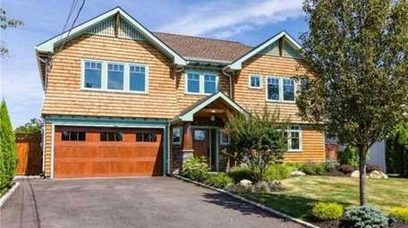 This waterfront Merrick splanch has four bedrooms and