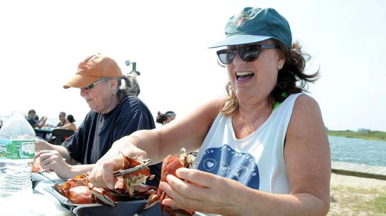 Kathy Pascale, of Mastic Beach, works on preparing