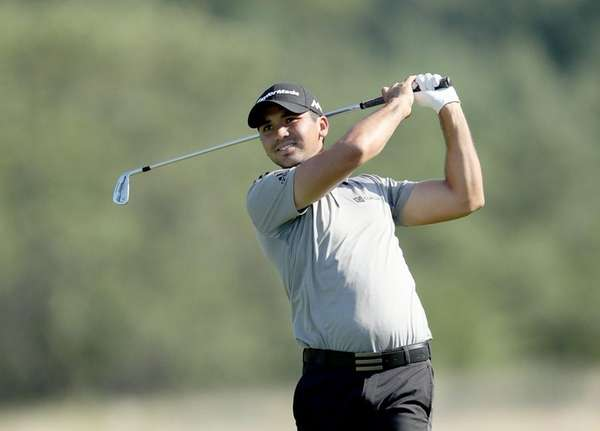 Jason Day golfs during the first round of