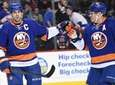 Islanders right wing Kyle Okposo, right, congratulates