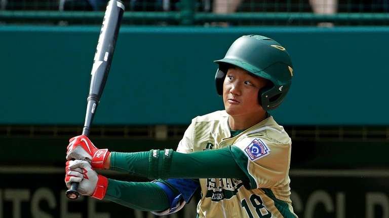 South Korea's Jaekyeong Kim watches his three-run home