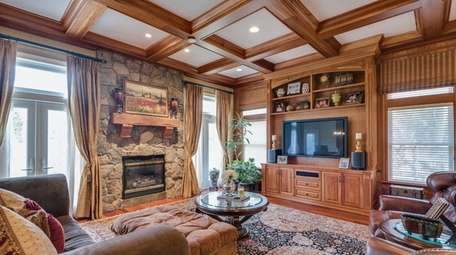 The family room of this Kings Park Colonial