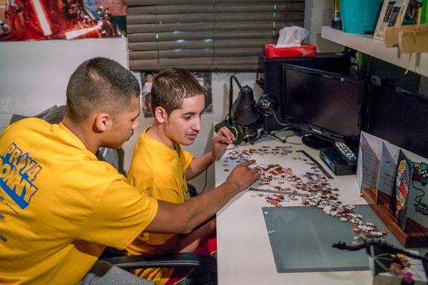 TJ Maldonado, left, helps finish a puzzle with