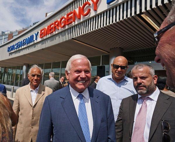 John Bohlsen, center, greets friends outside the new