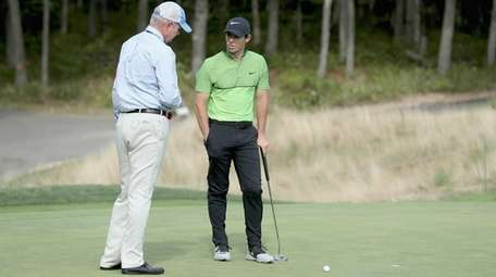 Rory McIlroy of Northern Ireland gets a ruling