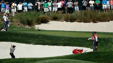 Jason Day hits out of the sand trap