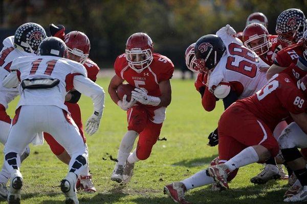 East Islip running back Justin Taveras runs through