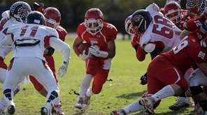 East Islip running back Justin Taveras  runs through