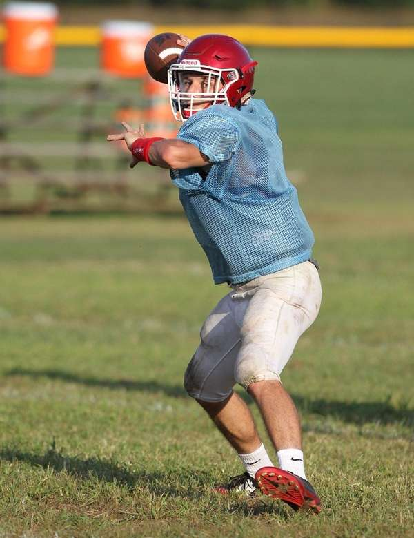 Bellport's Jimmy Morrell looks to pass during football