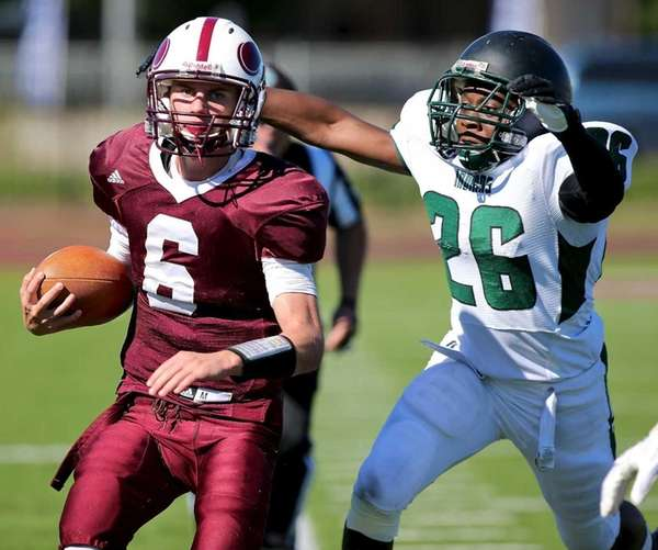 Bay Shore QB Matt Ilchuk gets chased by