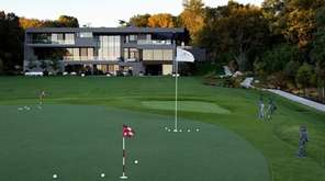 The Sands Point property includes a golf simulator,
