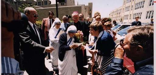 Mother Teresa of Calcutta is surrounded by admirers
