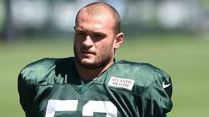 Jets linebacker Mike Catapano stretches during training camp