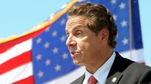 Governor Andrew Cuomo, walks away from the podium