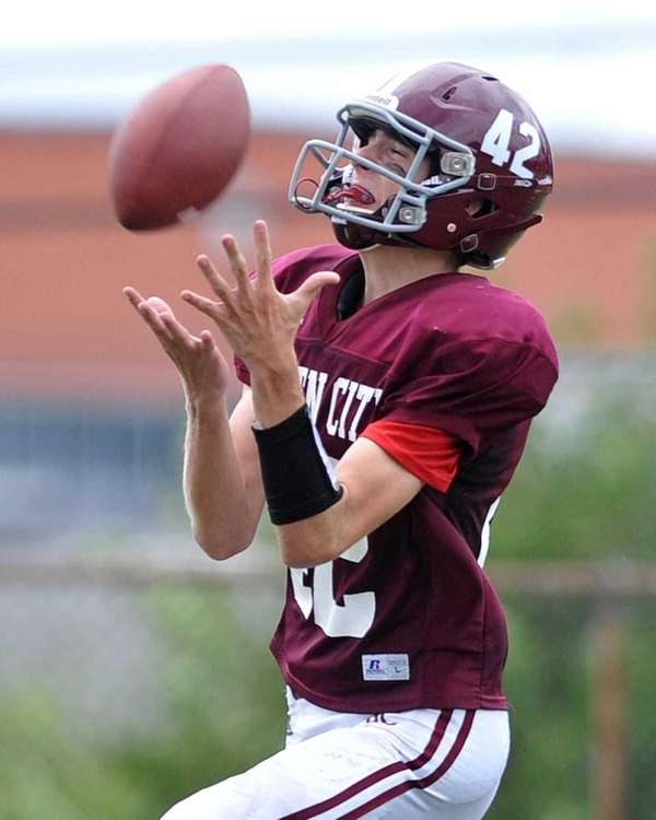 Garden City's Andrew DeSantis fields a punt during