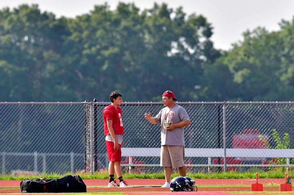 Smithtown East Head coach Jon Woods speaks with