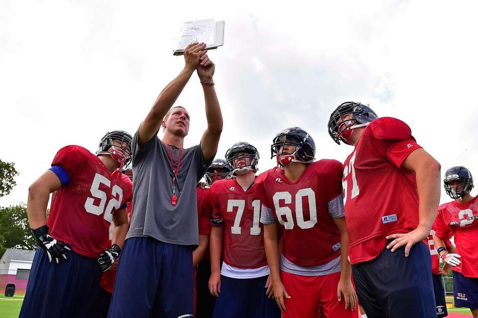 Smithtown East coach Brian Connors explains the play