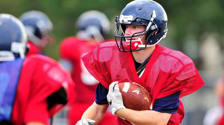 Smithtown East running back Mike Marino carries the