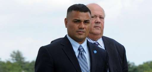 Bryan Arias, left, leaves federal court in Central