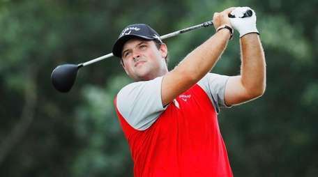 Patrick Reed hits his tee shot on the