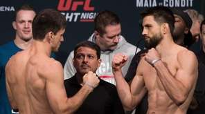 Demian Maia, left, of Brazil, and Carlos Condit,